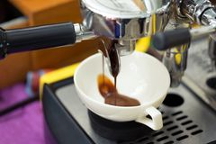 Pouring from coffee machine Stock Photos