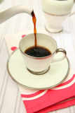 Pouring coffee retro cup royalty free stock photos