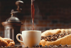 Pouring coffee surround coffee bean with background. Pouring hot coffee surround coffee bean with background Royalty Free Stock Images