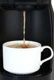 pouring coffee in white cup Royalty Free Stock Photography