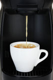 pouring coffee in white cup Royalty Free Stock Photo