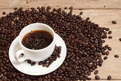 Pouring Coffee With Rosted Coffee Beans In White Cup Stock Photo