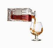 Pouring cognac Royalty Free Stock Photo