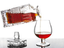 Pouring cognac Stock Photography