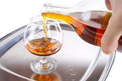 Pouring cognac Royalty Free Stock Image
