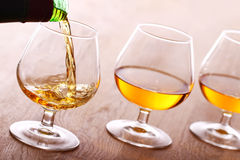 Pouring cognac into the glass Royalty Free Stock Photo