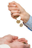 Pouring coins into hands Royalty Free Stock Photos
