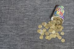 Spread the coins from the glass royalty free stock photo