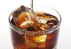 Pouring cola Royalty Free Stock Photos