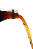Pouring cola Stock Image