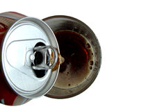 Pouring cola into glass. Pouring cola from can into a glass Royalty Free Stock Image