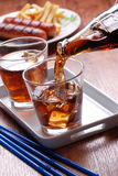 Pouring cola in glass Stock Photography