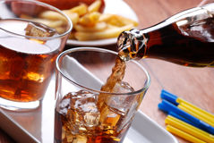 Pouring cola in glass Royalty Free Stock Images