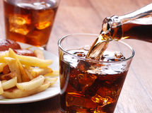 Pouring cola in glass Stock Photo