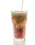 Pouring cola into glass with ice cubes isolated Stock Photo