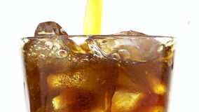 Pouring Cola into a Glass with the Ice Cubes. stock video