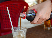 Pouring cola into the glass Royalty Free Stock Photo