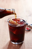 Pouring cola into kalimotxo mixture glass Royalty Free Stock Photography