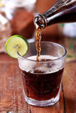 Pouring cola to a glass Royalty Free Stock Images