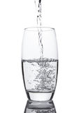 Pouring cold fresh healthy still water to glass Stock Photo