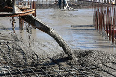 Pouring Concrete. At Construction Site Royalty Free Stock Photos