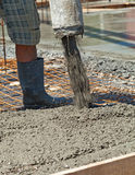 Pouring concrete at a construction site - closeup Stock Photos