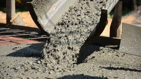 Pouring concrete liquid to block stock footage