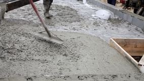 Pouring concrete mix from cement mixer on concreting stock video