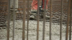 Pouring concrete mix from cement mixer on concreting formwork. Finished leveling the slab and pouring the concrete stock video footage
