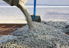 Pouring concrete. For a new driveway near the road Royalty Free Stock Photo