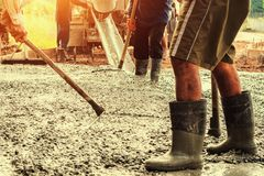 pouring concrete with worker mix cement for building road at con royalty free stock photo