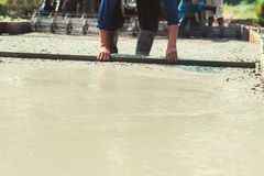 pouring concrete with worker mix cement at construction royalty free stock image