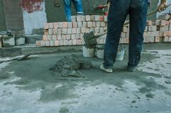 Pouring concrete with worker mix cement at construction site stock image
