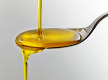 Pouring cooking oil Royalty Free Stock Image