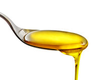Pouring cooking oil Royalty Free Stock Images