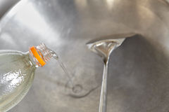 Pouring cooking oil. Into the wok Royalty Free Stock Photography