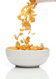 Pouring cornflakes into a bowl, Stock Photos