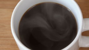 Pouring Cream or Milk in Hot Black Coffee stock footage