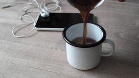 Pouring a cup of coffee. In cup stock video