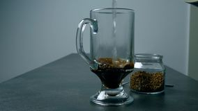 Pouring a cup of coffee. Preparing black coffee. Pouring a cup of coffee with hot water stock video footage