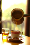 Pouring Cup Of Coffee royalty free stock photography