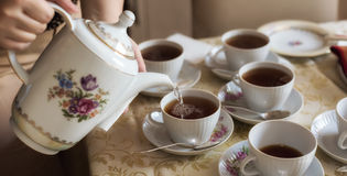 Pouring cup of tea Stock Photography