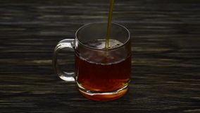 Pouring cup of tea slow motion.  stock footage