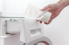 Pouring detergent into the washing machine Royalty Free Stock Photo