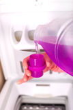Pouring detergent for washing machine Royalty Free Stock Image