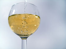 Pouring Drink. Drink being poured into wine glass stock image