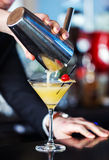 Pouring drink. Bartender pouring a shaken drink Stock Photo