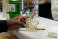 Pouring A Drink. Bartender Pouring A Whiskey Drink on The Rocks Royalty Free Stock Photo