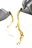 Pouring engine oil. From its plastic containers Royalty Free Stock Image