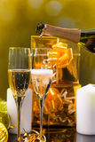 Pouring festive champagne for Christmas Stock Photos